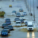 Cars on flooded road VICTVS Global Network