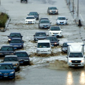 Cars on flooded road - Global Network
