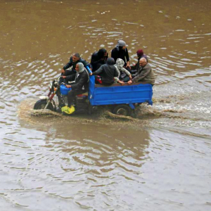 Men in truck on flooded road - Global Network