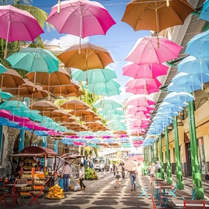 Colourful marketplace with bright umbrellas in a canopy over the street.